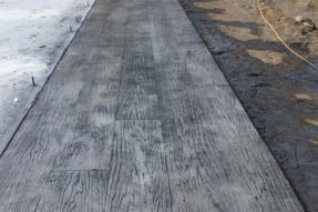 Cement Ramps and Sidewalks - We are concrete contractors offering paving, construction and repair of driveways, sidewalks, ramps, curbs, and more.